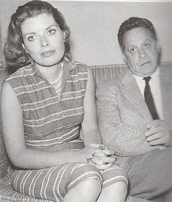Carol Van Ronkel and her husband sitting  on a couch.