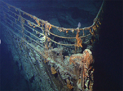 photo of the Titanic at the bottom  of the ocean.